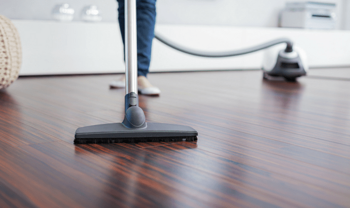 Clean the floor and encompassing area utilizing a vacuum and cloth