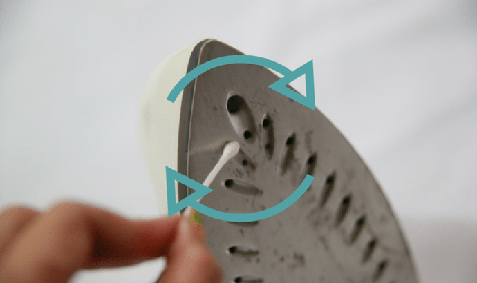 Utilize a cotton swab to clean the steam openings